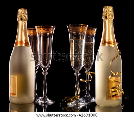 Glasses of champagne with bottle - stock photo
