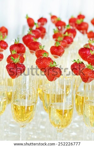 Glasses of champagne with strawberry - stock photo