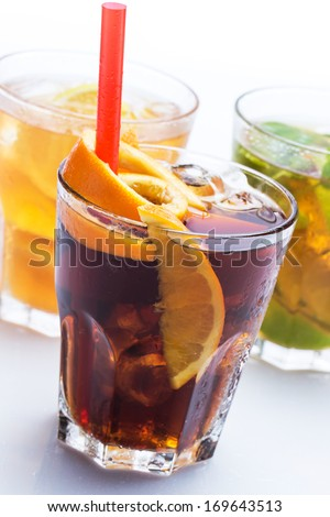 Glasses of cocktails with different citrus fruits  - stock photo