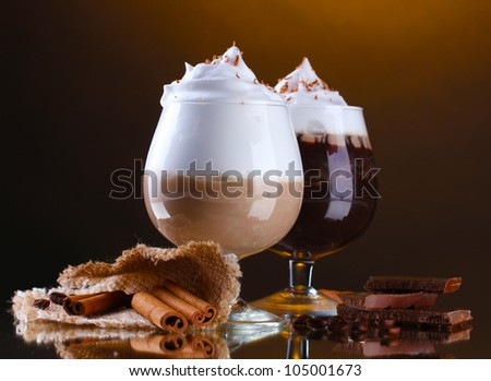 glasses of coffee cocktail on brown background - stock photo