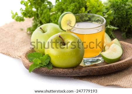 Glasses of fresh apple juice with apples - stock photo
