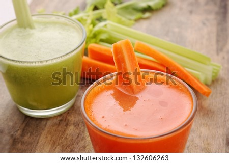 glasses of fresh vegetable juices  on wooden background - stock photo