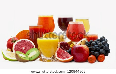 Glasses of fruit and vegetable juice with fruits on a white background - stock photo