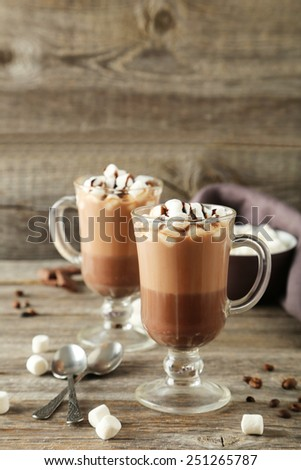Glasses of hot chocolate with marshmallows on grey wooden background - stock photo
