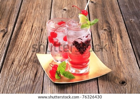 Glasses of iced drinks on a gold plate - stock photo