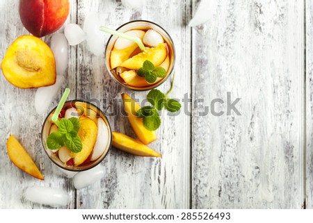 Glasses of Peach Iced Tea. Top view - stock photo