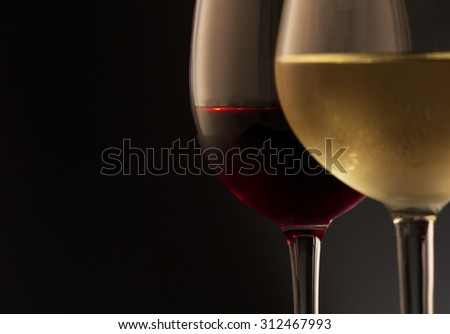 Glasses of red and white wine - stock photo