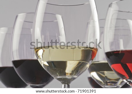 Glasses of red, rose and white wine. - stock photo