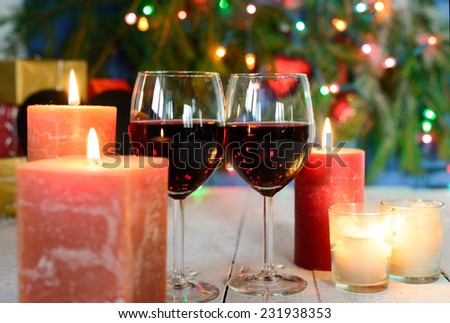 glasses of red wine with Christmas decoration - stock photo