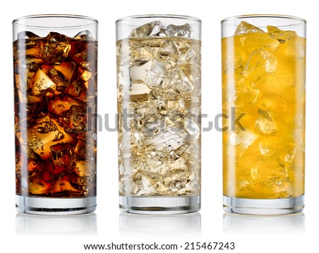 Glasses of sweet carbonated drinks with ice cubes isolated on white. With clipping path - stock photo