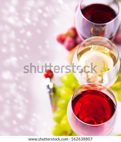 Glasses of white and rose wine and grapes, christmas concept - stock photo