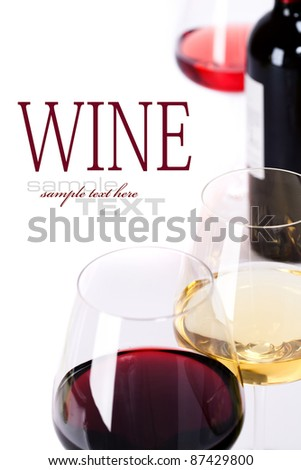 Glasses of white, red and rose wine  over white (with sample text) - stock photo