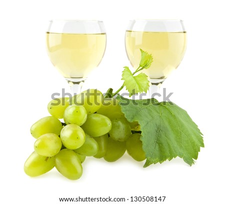 glasses of wine and cluster of vine on a white background - stock photo