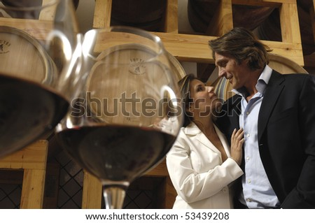 Glasses of wine and couple - stock photo
