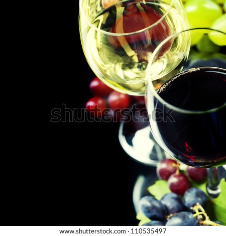 Glasses of  wine and grape over black - stock photo