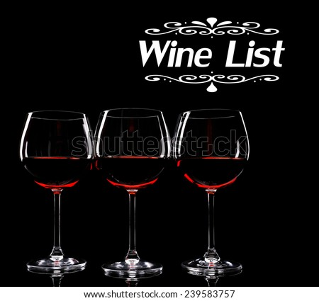 Glasses of wine isolated on black as Wine List - stock photo