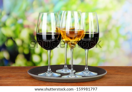 Glasses of wine, on bright background - stock photo