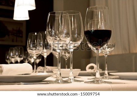 Glasses of wine set at restaurant table. - stock photo