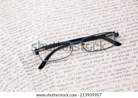 glasses on a background of letters - stock photo