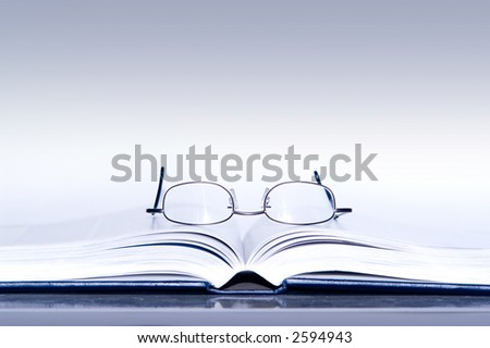 glasses on a book - stock photo
