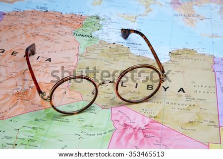Glasses on a map - Libya  - stock photo