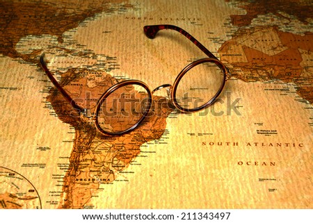 Glasses on a map of a world - Brazil - stock photo