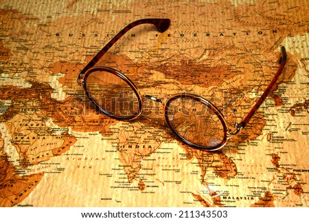 Glasses on a map of a world - China - stock photo