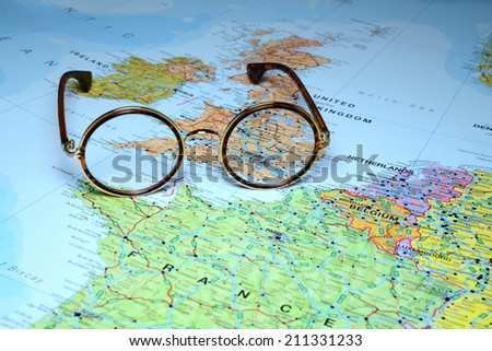Glasses on a map of europe - London - stock photo