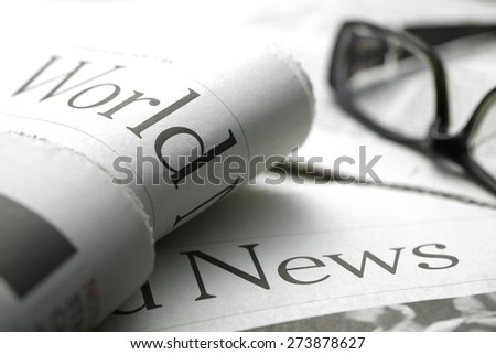 Glasses on newspaper,shot with very shallow depth of field. - stock photo