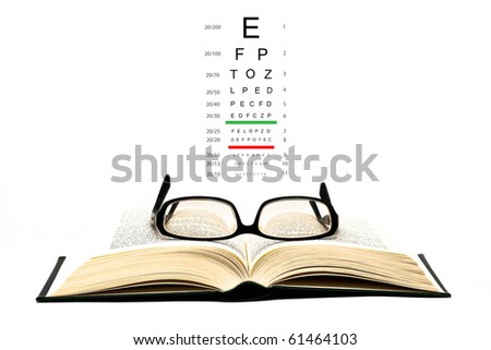 glasses on open book - stock photo