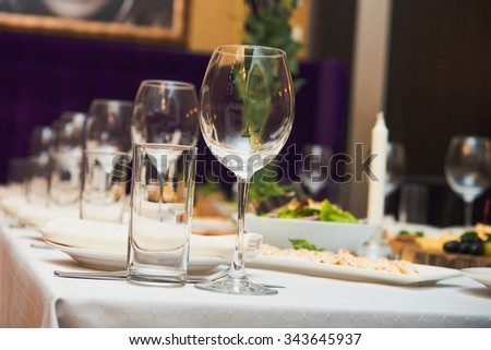 glasses on restaurant. table appointments. - stock photo