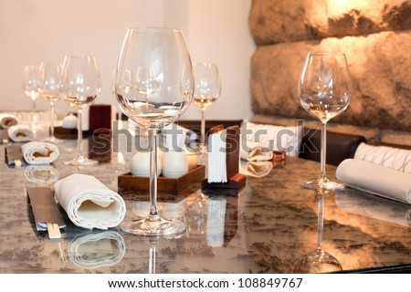 Glasses on table in sushi restaurant, focus on glass - stock photo