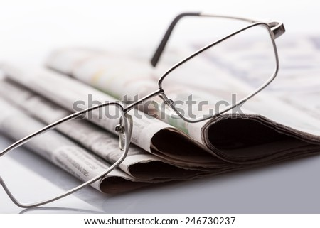 Glasses on the newspapers - stock photo