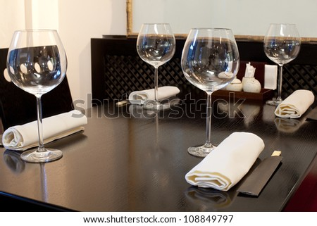 Glasses wine on table in sushi restaurant - stock photo