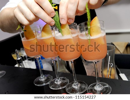 glasses with a cocktail in bar - stock photo