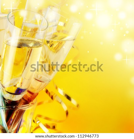 Glasses with champagne, a New Year's background - stock photo
