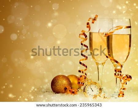 Glasses with champagne, clock close to midnight and Christmas balls on sparkling holiday background - stock photo