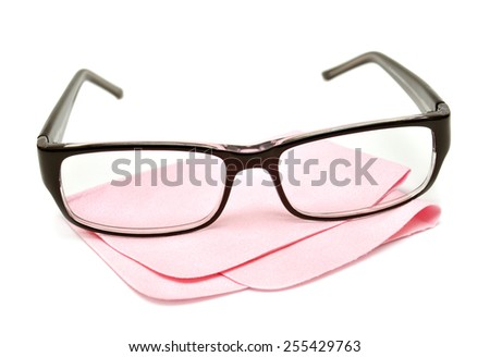 Glasses with cloth for care isolated on white background - stock photo
