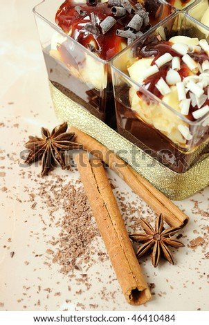 glasses with color creamy desserts and species - stock photo