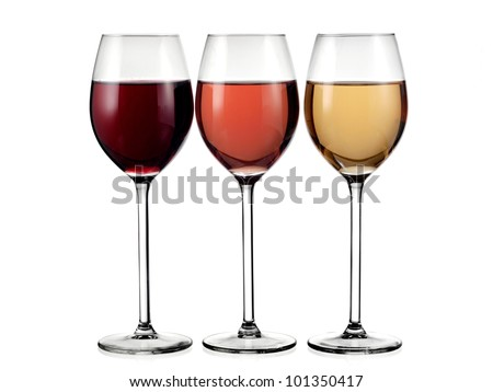Glasses with red, rose and white wine - stock photo