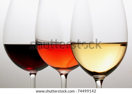 Glasses with red, white and rose wine. - stock photo