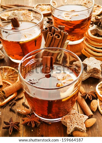 Glasses with rooibos tea, spices and cookies. Shallow dof. - stock photo