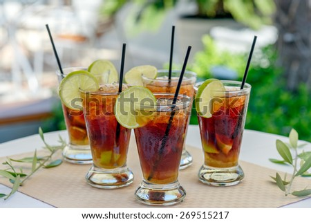 Glasses with rum cocktail - stock photo