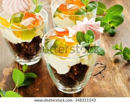 Glasses with sweet parfait dessert. Shallow dof. - stock photo