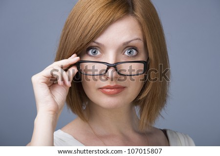 Glasses woman showing eyewear happy holding glasses frame. Closeup of young caucasian woman - stock photo