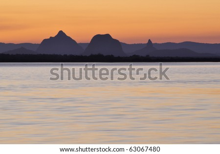 Glasshouse Mountains from Bribie Island - stock photo