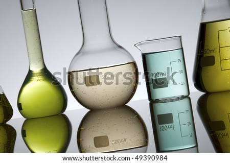 glassware group with color liquid at backlit - stock photo