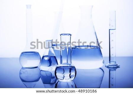 Glassware in laboratory in blue - stock photo