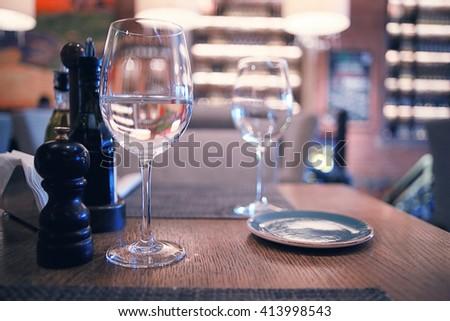 Glassware in the interior of the restaurant - stock photo