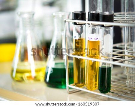 Glassware with chemical liquid in laboratory - stock photo